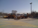 big machines and snow pile