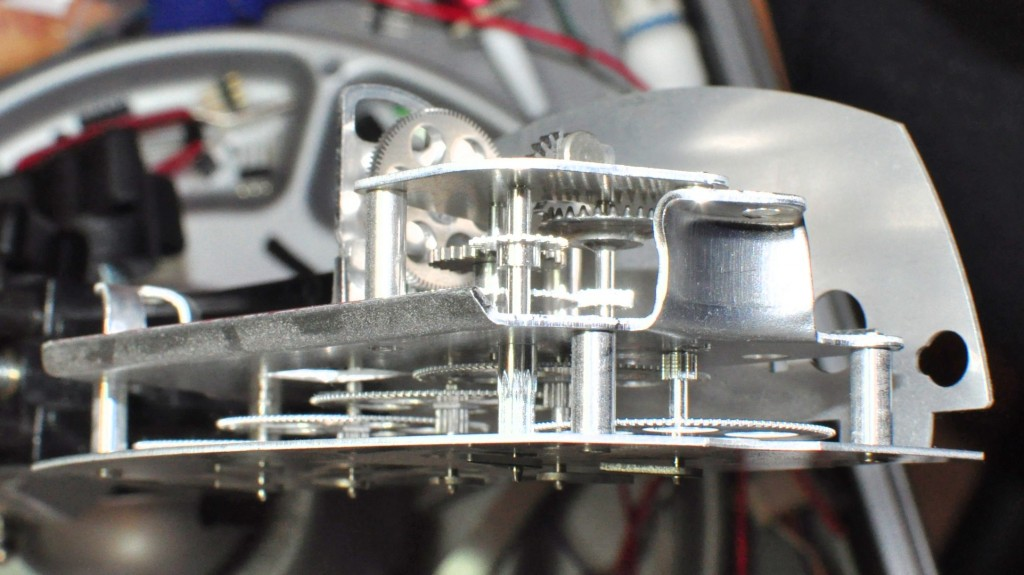 the fiddly gear-train inside a five-dial analogue kWh meter
