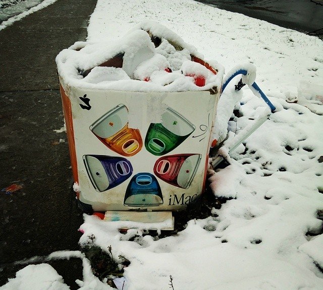 Once the Coolest Box on the Block™, now a soggy trash receptacle in the slush